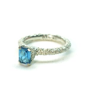 textured sunken eroded silver ring with london blue topaz