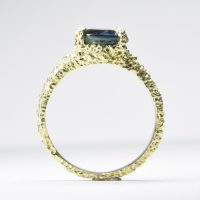 oval australian sapphire set in eroded 18ct gold ring