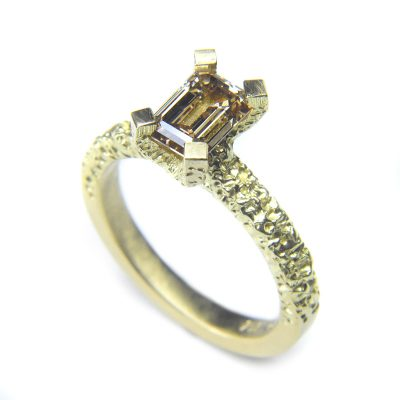 1ct emerald cut chamagne diamond set in eroded 18ct gold