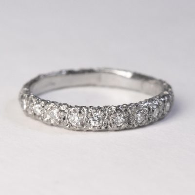 nine diamonds in eroded 18ct white gold ring