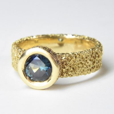 sapphire halo ring 18ct gold with champagne diamonds