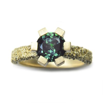 rook engagement ring round teal australian sapphire set in eroded 18ct gold ring