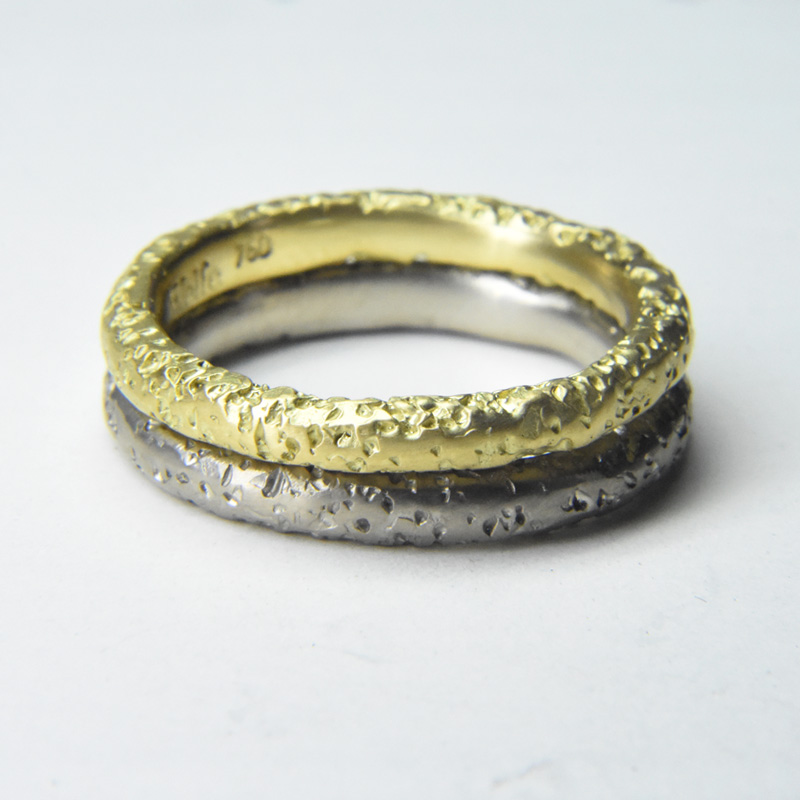 pitted staker rings in 18ct yellow and white gold