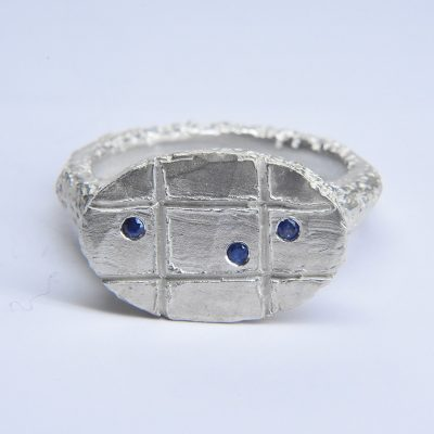 welfe jewellery rough carved oval signet ring in sterling silver with blue sapphires