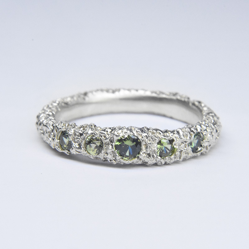 sunken stones ring in eroded 9ct white gold and sapphires
