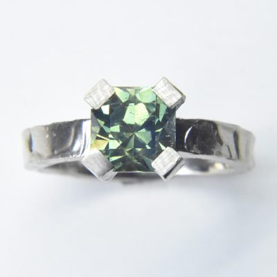 melted 18ct white gold engagement ring with 2ct eucalyptus australian sapphire